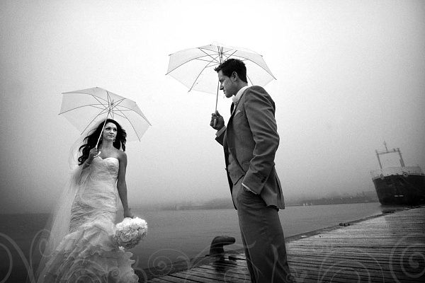 wedding photo taken at the docks on Polsen Street Toronto by Mark Anthony Studios in Black and White.